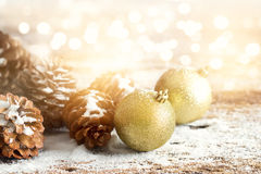 Gold christmas ornament pine cones on wooden Royalty Free Stock Photo