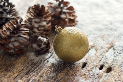 Gold Christmas Ornament Pinecones on wooden background. Gold Christmas Ornament Pine cones on wooden background Royalty Free Stock Images