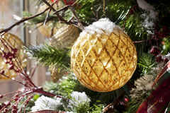 Gold Christmas Ornament on Tree Stock Photography