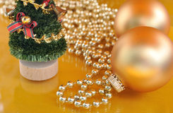 Gold christmas ornaments on gold background Stock Images