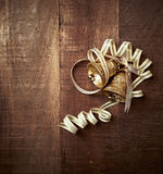 Gold Christmas ornaments on a rustic wooden background Stock Images