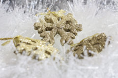 Gold Christmas ornaments Royalty Free Stock Photo