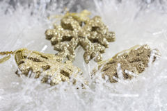 Gold Christmas ornaments Royalty Free Stock Images