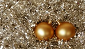 Gold Christmas Ornaments in Tinsel Royalty Free Stock Photography