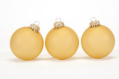 Gold Christmas Ornaments. On white background Royalty Free Stock Images