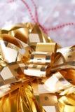 Gold christmas present Stock Image