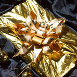 Gold christmas present Royalty Free Stock Photography