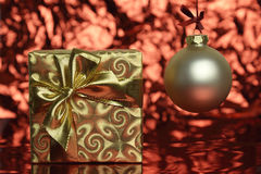 Gold Christmas present and ornament Royalty Free Stock Photos