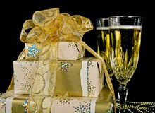 Gold Christmas presents with champagne Stock Photos