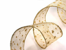 Gold Christmas ribbon on white Stock Photo