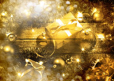 Gold Christmas Scene. A gold Christmas scene with lights, tinsel and presents royalty free stock photos