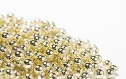 Gold christmas shiny bead decorations Stock Image