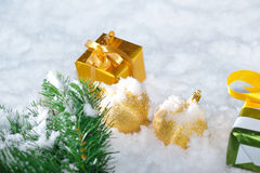 Gold  Christmas on snow Stock Photography