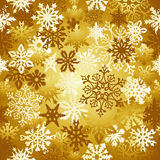 Gold Christmas snowflakes pattern Stock Photography