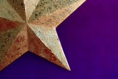 Golden christmas star. A closeup picture of a golden christmas decoration Stock Photography