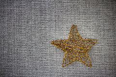 Gold Christmas star on grey background Royalty Free Stock Image