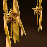 Gold christmas star with ribbons Royalty Free Stock Photography