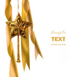 Gold christmas star with ribbons Stock Photo