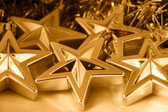 Gold Christmas stars. Decorations - background use Royalty Free Stock Photography