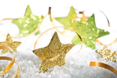 Gold Christmas stars. With band on the snow Stock Photography