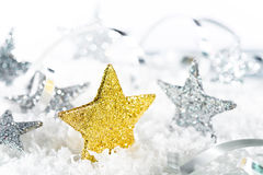 Gold Christmas Stars. With Glitter in the Snow Stock Image