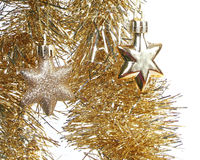 Gold Christmas toy stars and sparkling tinsel Stock Photos
