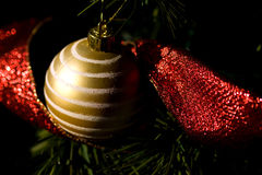 Gold Christmas Tree Adornment. Gold Christmas Tree Decorations with a Red Ribbon stock image