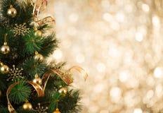 Gold Christmas tree background of defocused lights
