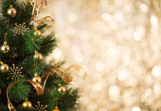 Gold Christmas tree background of defocused lights. Gold Christmas background of defocused lights with decorated tree royalty free stock photography