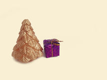 Gold Christmas tree candle and small gifts Royalty Free Stock Photos
