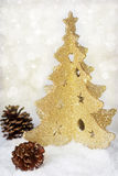 Gold christmas tree and cones Stock Images