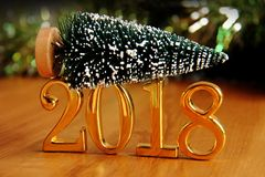 Gold 2018 and christmas tree decoration. Royalty Free Stock Images