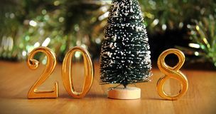 Gold 2018 and christmas tree decoration. Stock Photos