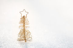 Gold Christmas tree decoration on snow Stock Photos