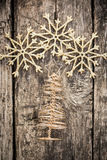 Gold Christmas tree decorations on grunge wood Royalty Free Stock Photos
