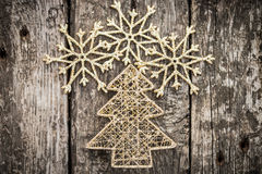 Gold Christmas tree decorations on grunge wood Stock Photos