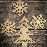 Gold Christmas tree decorations on grunge wood. Background. Winter holidays concept Royalty Free Stock Photo