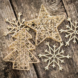 Gold Christmas tree decorations on grunge wood. Background. Winter holidays concept Stock Photos