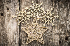 Gold Christmas tree decorations on grunge wood. Background. Winter holidays concept Royalty Free Stock Photography