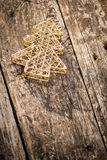 Gold Christmas tree decorations on grunge wood. Background. Winter holidays concept. Copy space for your text Stock Images