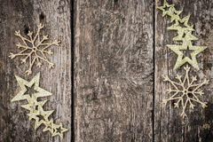 Gold Christmas tree decorations on grunge wood. Background. Winter holidays concept. Copy space for your text Stock Image