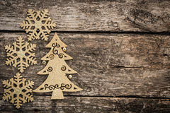 Gold Christmas tree decorations on grunge wood. Background. Winter holidays concept. Copy space for your text Stock Photography
