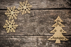 Gold Christmas tree decorations on grunge wood. Background. Winter holidays concept. Copy space for your text Royalty Free Stock Images