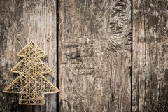 Gold Christmas tree decorations on grunge wood Royalty Free Stock Photo
