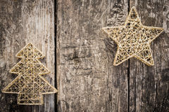 Gold Christmas tree decorations on grunge wood Stock Images