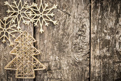 Gold Christmas tree decorations on grunge wood. Background. Winter holidays concept. Copy space for your text Royalty Free Stock Image