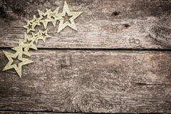 Gold Christmas tree decorations on grunge wood. Background. Winter holidays concept. Copy space for your text Stock Photos