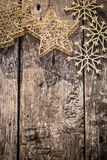 Gold Christmas tree decorations on grunge wood. Background. Winter holidays concept. Copy space for your text. Shallow depth of fields Royalty Free Stock Images
