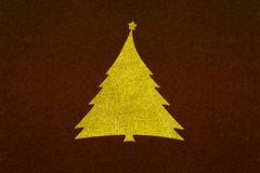 Gold christmas tree fiber on dark brown paper texture Royalty Free Stock Photos