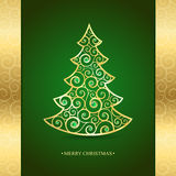 Gold Christmas tree on a green background Royalty Free Stock Image